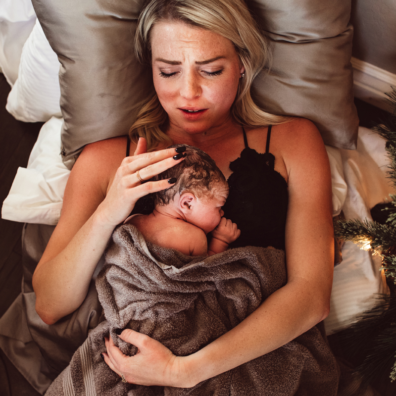 Salt Lake City Doula, mother cradling newborn to her chest